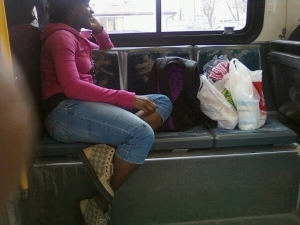 incosiderate_girl_with_too_many_bags_taking_all_the_space_on_the_bus